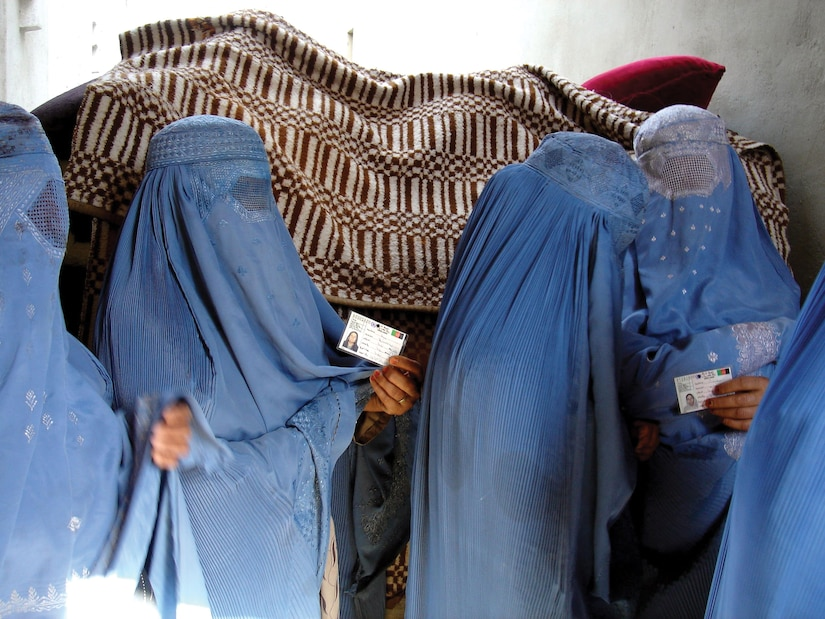 Afghan women standing in line to vote for Afghanistan's national assembly.