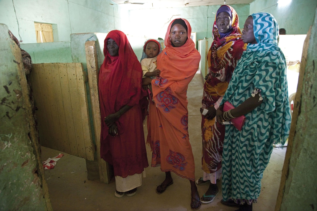 men in line at polling center in Nyala, South Darfur, on the first day of voting in South Sudan's referendum on independence in January 2011.