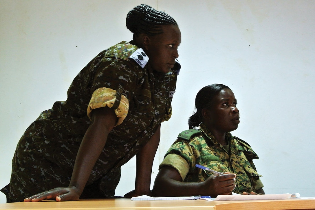 Two female Uganda People's Defense Force soldiers participate in the Dallaire Initiative's Women and Security Sector training in Jinja, Uganda.