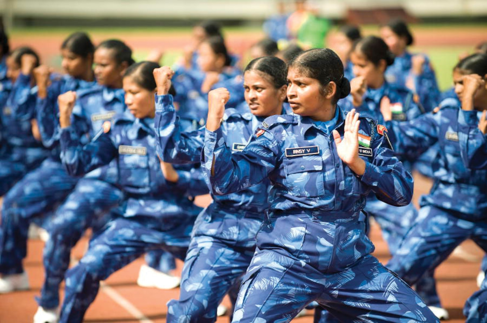 Members of the all-female Indian Formed Police Unit of the United Nations Mission in Liberia (UNMIL) perform a martial arts exercise prior to receiving medals of honor in recognition of their service.