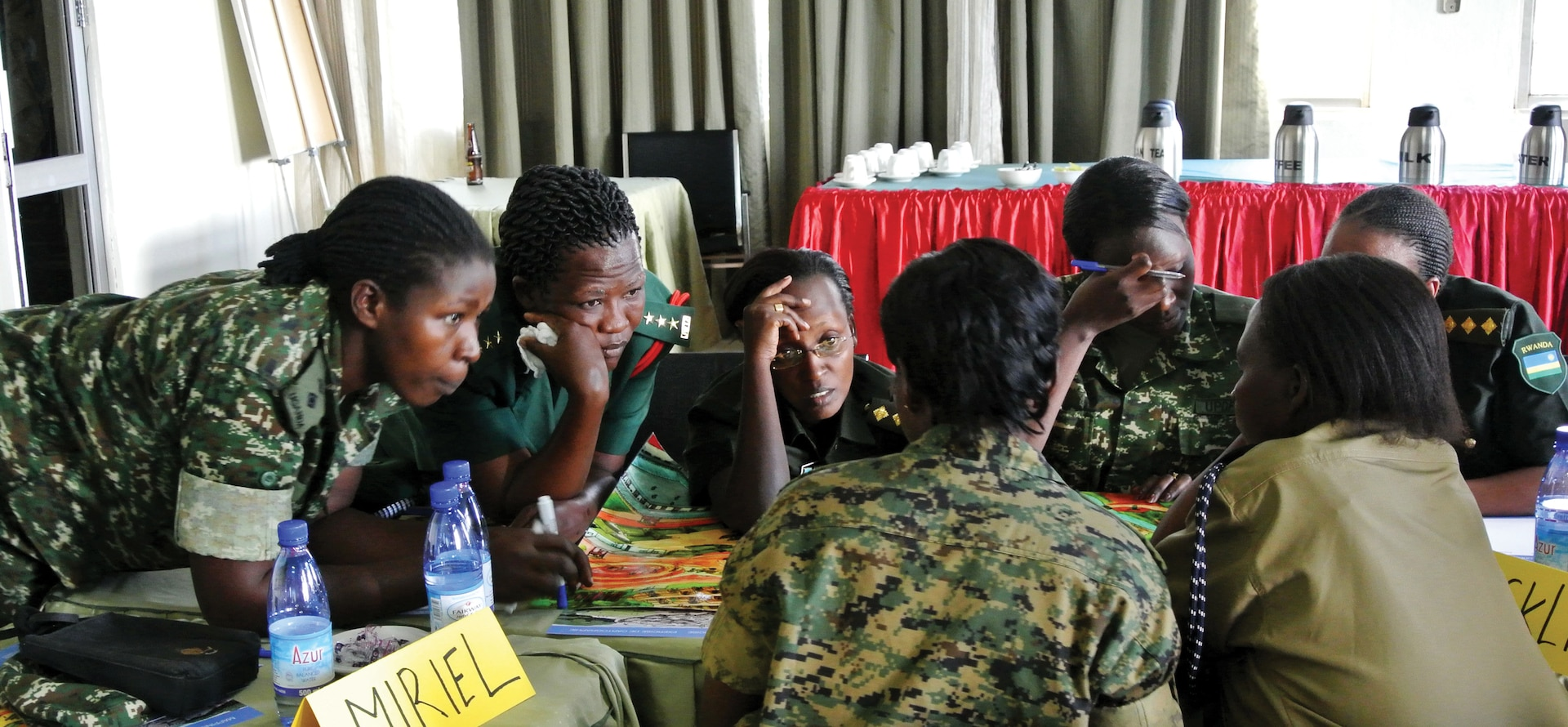 Women from the Uganda People's Defense Force (UPDF) work on a village mapping exercise in Kampala during Dallaire Initiative's Women and Security Sector training. The village mapping exercise teaches