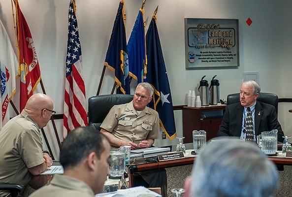 Vice Adm. Thomas Rowden, Commander, Naval Vice Adm. Thomas Rowden, Commander, Naval Surface Forces U.S. Pacific Fleet (middle) and Jim McClaugherty, deputy commander, DLA Land and Maritime (right) listen to Navy Rear Adm. John King, commander, DLA Land and Maritime (left) during a briefing for Rowden March 2 at Defense Supply Center Columbus. Rowden visited Columbus to hear about the capabilities of DLA and ways Land and Maritime can align with Rowden's forces in support of the warfighter.