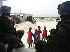 Brazilian soldiers of the MINUSTAH peacekeeping contingent on a routine patrol in Cité Soleil, Haiti.