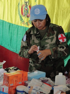 Bolivian peacekeeper providing medical and dental support for internally displaced persons in Cité Soleil, Haiti.