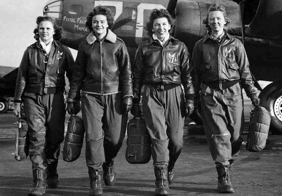"Women Airforce Service pilots Frances Green, Margaret ""Peg"" Kirchner, Ann Waldner and Blanche Osborn, leave their B-17 Flying Fortress aircraft, ""Pistol Packin' Mama,"" during ferry training at Lockbourne Army Airfield, Ohio, 1944. Air Force photo"