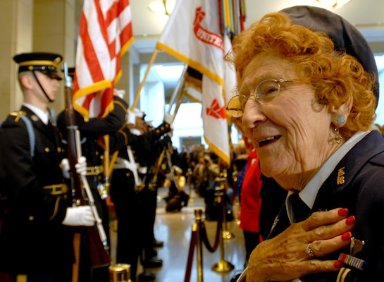 Betty Wall Strohfus, right, a former pilot with the Women Airforce Service Pilots (WASP), sings the national anthem during the Congressional Gold Medal ceremony at the Capitol in Washington, D.C., March 10, 2010. Strohfus passed away in 2016. Air Force photo by Staff Sgt. J.G. Buzanowski