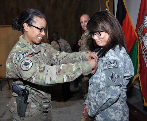 Then-Lt. Col. Yvonne Spencer presents an award to Sai Shasrp in Kabul, Afghanistan, during a Transatlantic District North house meeting in 2012. (USACE photo/M. Beeman)