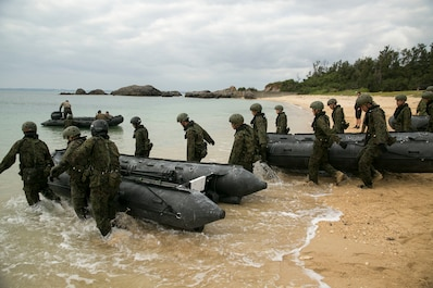 Service members with the Japan Ground Self-Defense Force pull Combat Rubber Raiding Craft into the water at Kin Blue, Okinawa, Japan, March 1. The JGSDF members observed Marines from 3rd Reconnaissance Battalion, 3rd Marine Division, III Marine Expeditionary Force,  practice scout swimmer techniques and conduct raid missions. The JGSDF members are with 43rd Infantry Regiment. (U.S. Marine photo by Cpl. Robert Williams Jr./Released)