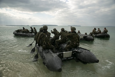 Service members with the Japan Ground Self-Defense Force paddle out to sea in Combat Rubber Raiding Craft at Kin Blue, Okinawa, Japan, March 1. The JGSDF members observed Marines from 3rd Reconnaissance Battalion, 3rd Marine Division, III Marine Expeditionary Force, practice scout swimmer techniques and conduct raid missions. The JGSDF members are with 43rd Infantry Regiment. (U.S. Marine photo by Cpl. Robert Williams Jr./Released)