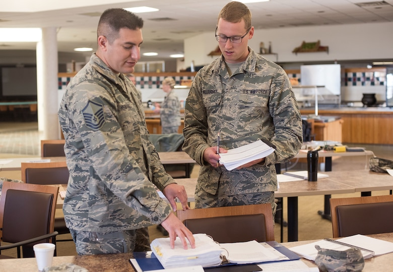 Master Sgt. John Hernandez, the 137th Air Refueling Wing safety and occupation health manager, and Senior Airman Jonathan Willoughby from the 137th Operations Support Flight, 137th Air Refueling Wing, Oklahoma City, discuss safety requirements and regulations after compiling data from a mock inspection at Will Rogers Air National Guard Base, Oklahoma City, Feb. 25, 2016. The inspection was part of an Air National Guard-wide, four-day safety orientation course, which was mainly for unit safety representatives and supervisors, that focused on the importance of safety and mishap prevention. (U.S. Air National Guard photo by Senior Airman Kasey Phipps)