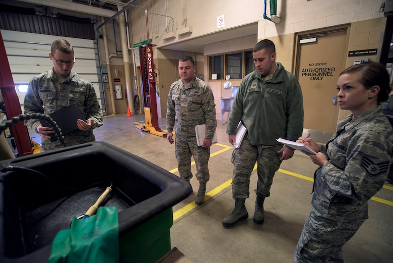 Airmen from the 137th Air Refueling Wing, Oklahoma City, and 190th Air Refueling Wing, Topeka, Kansas, check and discuss a washing station in the 137th Vehicle Maintenance Squadron at Will Rogers Air National Guard Base in Oklahoma City during a mock inspection, Feb. 25, 2016. The inspection was part of an Air National Guard-wide, four-day safety orientation course, which was mainly for unit safety representatives and supervisors, that focused on the importance of safety and mishap prevention. (U.S. Air National Guard photo by Senior Airman Kasey Phipps)