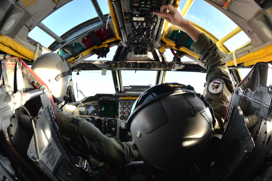 Capt.  Brian D'Arcy, B-52 Stratofortress copilot with the 2nd Bomb Wing's 20th Bomb Squadron, adjusts radio frequencies during a flight to the Trøndelag region of Norway as part of NATO exercise Cold Response 16, March 1, 2016. This year's iteration of the biennial military training exercise included air assets such as the B-52, F-16 Fighting Falcon, P-3 Orion and KC-135 Stratotanker, among others.  (U.S. Air Force photo/Senior Airman Joseph Raatz)
