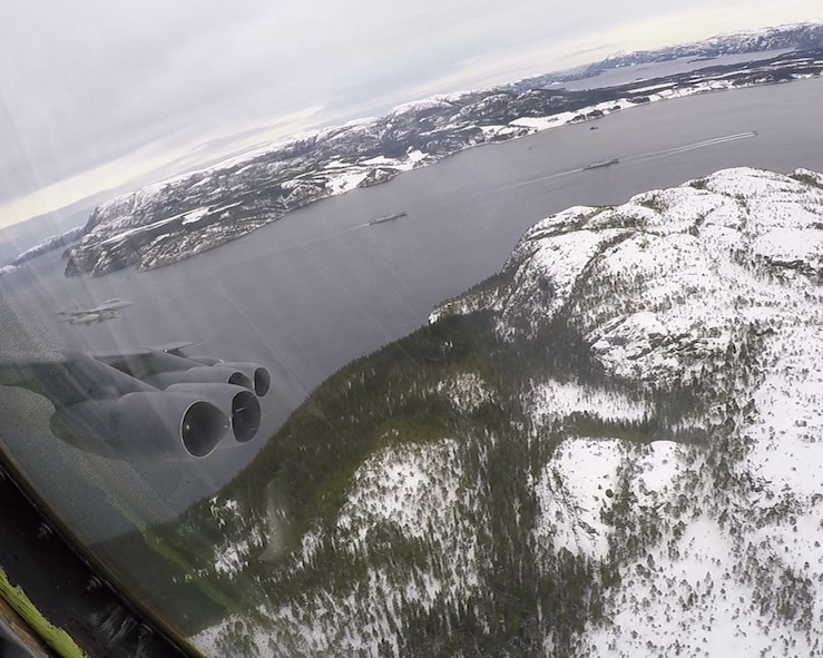 A Royal Norwegian Air Force F-16 Fighting Falcon and several naval vessels can be seen off the wing of a U.S. Air Force B-52 Stratofortress as it flies over a fjord in the Trøndelag region of Norway during NATO exercise Cold Response 16, March 1, 2016. More than 16,000 troops from a dozen Allied and partner nations participated in this year's iteration of the biennial military training exercise, jointly developing tactics, techniques and procedures that greatly increase their interoperability and coordination. Exercises like these sharpen NATO members' ability to defend themselves and their allies in any environment. (U.S. Air Force photo/Senior Airman Joseph Raatz)