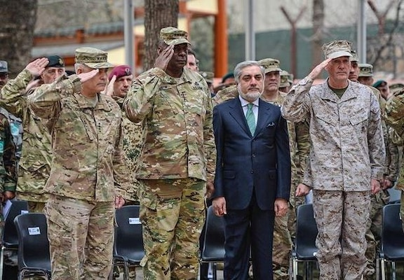 Marine Corps Gen. Joseph F. Dunford Jr., right, Army Gen. John F. Campbell, left, and Army Gen. Lloyd J. Austin III salute and stand with Afghan Chief Executive Officer Abdullah Abdullah during the change-of-command ceremony on Camp Resolute Support in Kabul, Afghanistan, March 2, 2016. (Air Force photo by Staff Sgt. Tony Coronado)