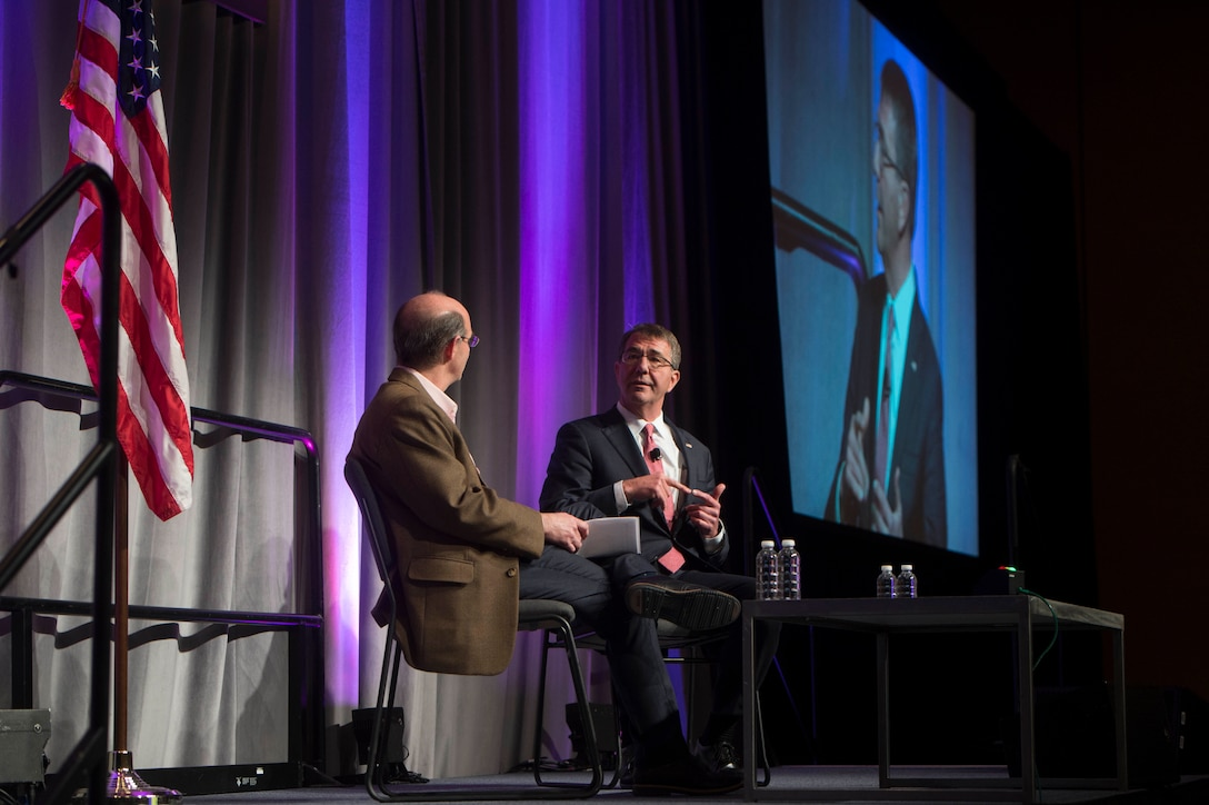 Defense Secretary Ash Carter, right, speaks at the RSA Conference in San Francisco, March 2, 2016. Carter is in San Francisco to strengthen ties between the Department of Defense and the tech community. DoD photo by Navy Petty Officer 1st Class Tim D. Godbee