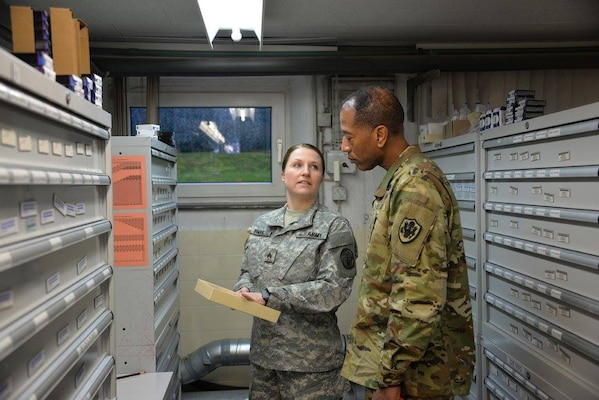 SGT Ashley Irmak, with the U.S. Army Medical Material Center, Europe in Pirmasens, Germany, provided Army Brig. Gen. Charles Hamilton, DLA Troop Support commander, a brief on the Optical Activities Division. Hamilton went to USAMMCE as part of his first visit to DLA Troop Support Europe and Africa.