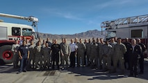 Maj. Gen. Timothy S. Green, Air Force Director of Civil Engineers, Deputy Chief of Staff for Logistics, Engineering and Force Protection, Headquarters U.S. Air Force, poses for a picture with members of the 99th Civil Engineer Squadron Fire Protection Flight on the flight line at Nellis Air Force Base, Nev., Feb. 24, 2016. During his visit, Green broke the news that the 99th Civil Engineer Squadron Fire Protection Flight had won four Air Force-Level Awards for their accomplishments during 2015. The awards included the Air Force Large Fire Department of the Year, Fire Prevention Program of the Year, Firefighter Heroism Award and Air Force Senior Fire Officer of the Year.