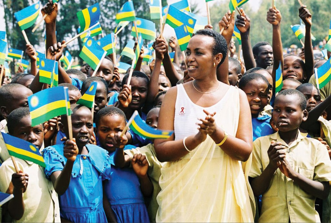 The late Aloisea Inyumba, then gender minister in Rwanda, stands in a Rwandan village. She placed 500,000 orphans with families after the genocide, ignoring Hutu and Tutsi distinctions.