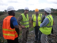New England District team members meet get a briefing at the Mount Coffee Hydropower Dam during the November 2015 site visit.