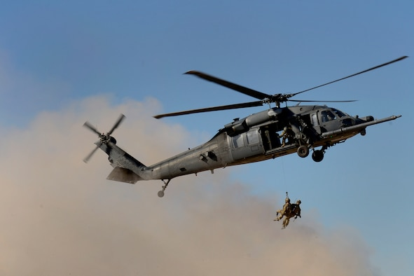 Staff Sgt. August O'Neil, an Air Force wounded warrior, and fellow pararescueman and wounded warrior, Staff Sgt. Nick Robillard, are hoisted from an HH-60G Pave Hawk during the opening ceremony of the 2016 U.S. Air Force Trials at Nellis Air Force Base, Nev., Feb. 26, 2016. The Air Force Trials are an adaptive sports event designed to promote the mental and physical wellbeing of seriously wounded, ill and injured military members and veterans. More than 100 service men and women from around the country competed for a spot on the Air Force team for the 2016 Warrior Games, which will take place in June at the U.S. Military Academy in West Point, N.Y. (U.S. Air Force photo/Staff Sgt. DeAndre Curtiss)