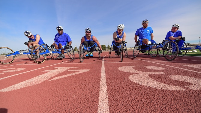 Wheelchair racing participants prepare to race during the 2016 Air Force Trials at Nellis Air Force Base, Nev., March 1, 2016. The Air Force Trials are an adaptive sports event designed to promote the mental and physical well-being of seriously wounded, ill and injured military members and veterans. More than 100 service men and women from around the country competed for a spot on the Air Force team for the 2016 Warrior Games, which will take place in June at the U.S. Military Academy in West Point, N.Y. (U.S. Air Force photo/Senior Airman Taylor Curry)