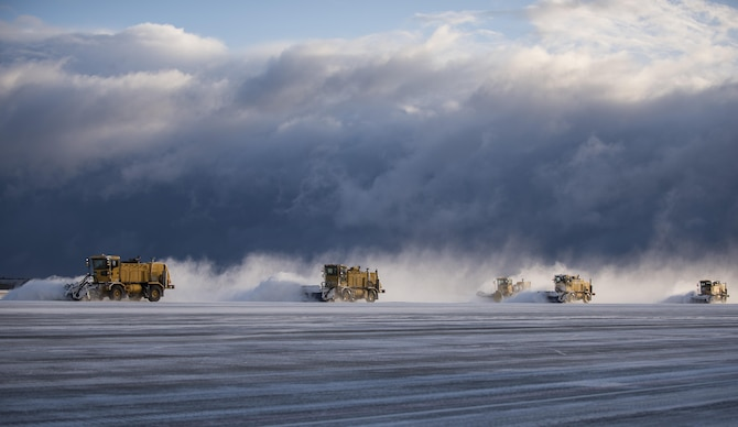 Members from 35th Civil Engineer Squadron operate air blast sweepers on the runway at Misawa Air Base, Japan, Feb. 24, 2016. Airmen from the 35th CES ensure the flying mission can be carried out and the base populous is able to safely commute during the winter. (U.S. Air Force photo/Senior Airman Brittany A. Chase)