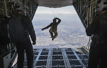 Tech. Sgt. Benjamin Jonas, the 374th Operations Support Squadron's survival, evasion, resistance and escape operations NCO in charge, jumps out of a C-130 Hercules while flying over Yokota Air Base, Japan, March 2, 2016. During the high-altitude, low-opening airdrop, Jonas jumped from 10,000 feet in the air and parachuted to the base. (U.S. Air Force photo/Senior Airman David Owsianka)