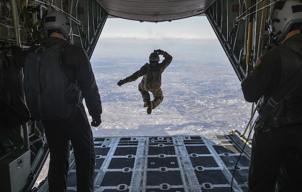Tech. Sgt. Benjamin Johnis, the 374th Operations Support Squadron's survival, evasion, resistance and escape operations NCO in charge, jumps out of a C-130 Hercules while flying over Yokota Air Base, Japan, March 2, 2016. During the high-altitude, low-opening airdrop, Johnis jumped from 10,000 feet in the air and parachuted to the base. (U.S. Air Force photo/Senior Airman David Owsianka)