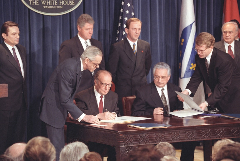 Male political leaders sign the Croat-Muslim Federation agreement at The White House in March 1994
