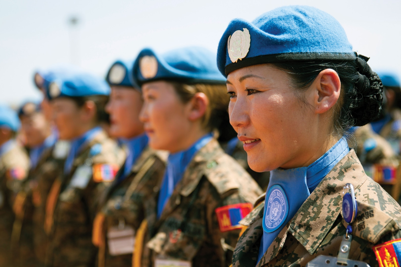 Mongolian peacekeepers stand at attention as they receive their medals for their service in the Republic of South Sudan.