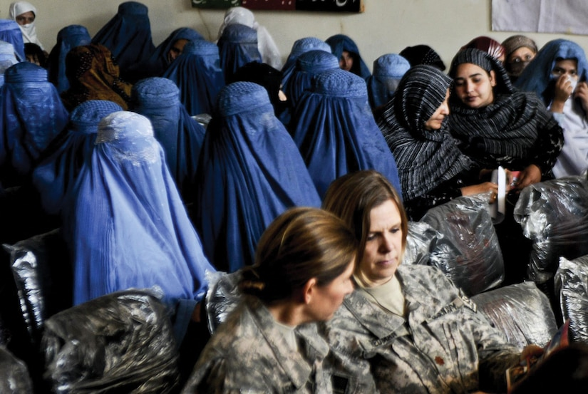 The National Guard State Partnership Program has forged many promising relationships with partner nations, allowing successful exchanges of knowledge, techniques, and ideas. Here, the Iowa National Guard's 734th Agribusiness Development Team and Afghan women from the Kunar Provincial Reconstruction Team gathered to celebrate Women's Day.