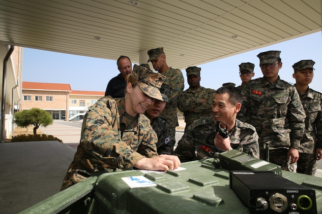 U.S. and Republic of Korea Marines work together to set up a Secure Communications Controller at the 2014 Ssang Yong exercise in Pohang, Republic of Korea. Marine Corps Systems Command is in the last stages of development of the SCC, which crosslinks incompatible radio and digital systems, making communication possible between U.S. and foreign military forces, governmental and non-governmental agencies, and among different Marine Corps radios. (Photo by Lance Cpl. Andrew Blanco, III Marine Expeditionary Force)