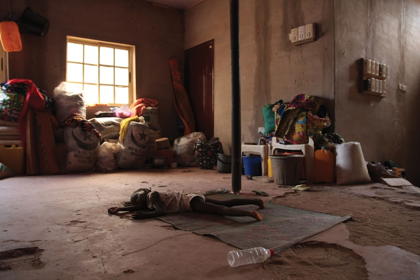 At St. Therese Church in Yola, a displaced girl rests.
