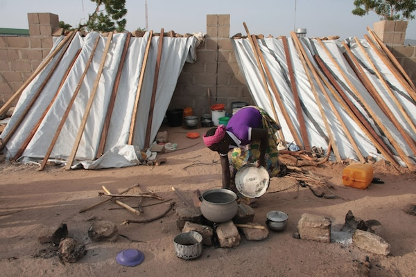 A woman displaced by Boko Haram prepares a meal at an IDP camp in Yola, Adamawa.