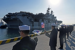 BUSAN, Republic of Korea (March 3, 2016) - Republic of Korea (ROK) Sailors wave U.S. and ROK flags as USS Bonhomme Richard (LHD 6) pulls into ROK Fleet base. Bonhomme Richard is the flagship of Expeditionary Strike Group (ESG) 7 and is visiting Busan on a regularly scheduled port visit