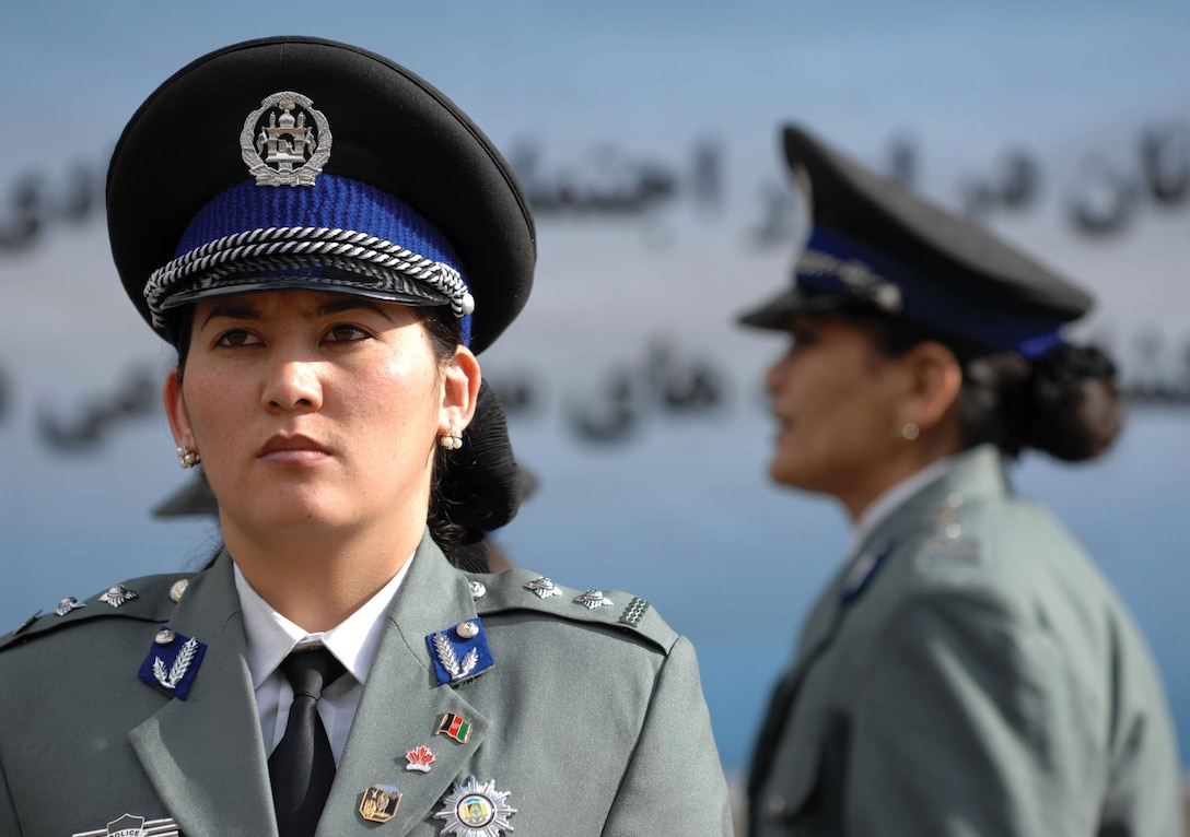 An Afghan National Policewoman (ANP) stands at attention