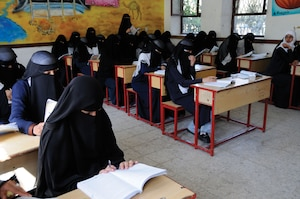 Students read in class at the Shaheed Mohamed Motaher Zaid School in Sana'a.