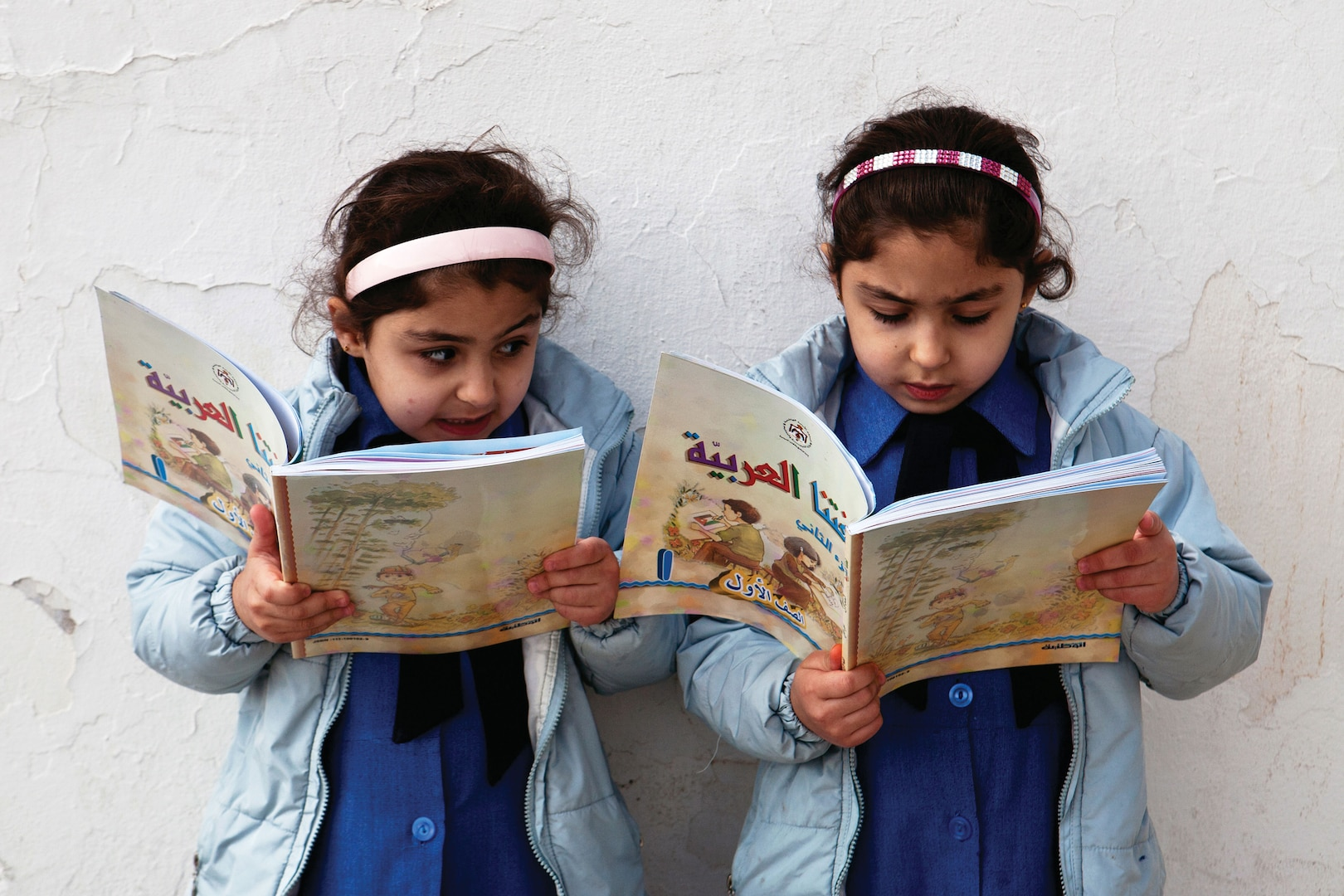 Young girls reading at a Jordanian primary school. Education and literacy are key elements of achieving gender equality.
