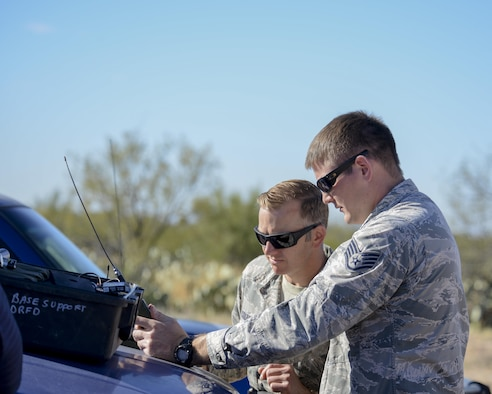 U.S. Air Force 355th Civil Engineer Squadron explosive ordnance technicians, Tech. Sgt. David Collins and Staff Sgt. Richard Weick, conduct a pre-operation check on a firing device at Davis-Monthan Air Force Base, Ariz., Feb. 18, 2016. The EOD flight practiced for the demonstration they will display at the upcoming 2016 Thunder and Lighting over Arizona open house.  (U.S. Air Force photo by Senior Airman Chris Massey/Released)