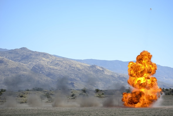 U.S. Airmen from the 355th Civil Engineer Squadron explosive ordnance disposal flight simulate an A-10C Thunderbolt II strafing run at Davis-Monthan Air Force Base, Ariz., Feb. 18, 2016.  The EOD flight practiced for the demonstration they will display at the upcoming 2016 Thunder and Lighting over Arizona open house.  (U.S. Air Force photo by Senior Airman Chris Massey/Released)