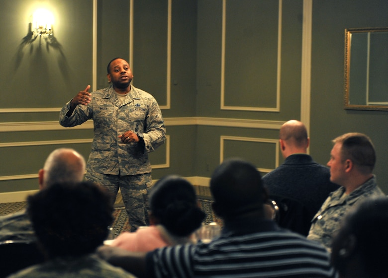 Master Sgt. Demetrius Booth, with the 55th Security Forces Squadron, speaks to attendees of the Offutt Diversity Team's Black History Month commemoration at the Offutt Air Force Base Patriot Club, Neb., Feb. 17, 2016. Booth spoke of the history of the Atlantic slave trade, as well as the progress made toward equal rights in the U.S.