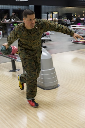 Col. Robert V. Boucher, commanding officer of Marine Corps Air Station Iwakuni, bowls during the kickoff of the Navy-Marine Corps Relief Society's active duty fund drive at the Strike Zone Bowling Center here Feb. 29, 2016. Since 1904, the NMCRS has provided assistance to Marines, Sailors and their families in times of need. By request of the commandant of the Marine Corps and the chief of naval operations, the NMCRS annually collects donations from active duty service members during March and April.