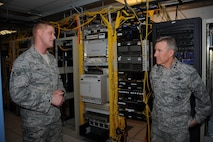 U.S. Air Force Senior Airman Mark Lindsay, 355th Communications Squadron network technician, speaks with U.S. Air Force Gen. Hawk Carlisle, commander of Air Combat Command, during a base tour at Davis-Monthan Air Force Base, Ariz., March 3, 2016. Carlisle visited various units during his tour, where Airmen briefed him about their part in completing the mission. Carlisle is responsible for organizing, training, equipping and maintaining combat-ready forces for rapid deployment and employment while ensuring strategic air defense forces are ready to meet the challenges of peacetime air sovereignty and wartime defense. (U.S. Air Force photo by Airman 1st Class Ashley Steffen/ Released)