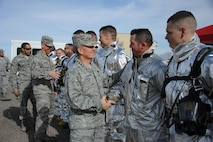 U.S. Air Force Gen. Hawk Carlisle, commander of Air Combat Command, and Chief Master Sgt. Steve McDonald, ACC command chief, meet 355th Civil Engineering Squadron fire emergency services flight Airmen during a base tour at Davis-Monthan Air Force Base, Ariz., March 3, 2016. The 355th CES Airmen had just conducted a live fire demonstration that Carlise and McDonald observed. ACC operates more than 1,300 aircraft, 34 wings, 19 bases, and more than 70 operating locations worldwide with 94,000 active-duty and civilian personnel. (U.S. Air Force photo by Airman 1st Class Ashley Steffen/Released)