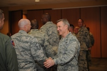 U.S. Air Force Gen. Hawk Carlisle, commander of Air Combat Command, shakes hands with U.S. Air Force Master Sgt. Jay Jundt, 355th Security Forces Squadron acting first sergeant at Davis-Monthan Air Force Base, Ariz., March 3, 2016. Carlisle discussed D-M AFB's missions with the Airmen. Carlisle is responsible for organizing, training, equipping and maintaining combat-ready forces for rapid deployment and employment while ensuring strategic air defense forces are ready to meet the challenges of peacetime air sovereignty and wartime defense. (U.S. Air Force photo by Senior Airman Cheyenne A. Powers/ Released)