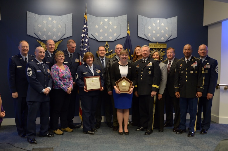 Members of the 157th Air Refueling Wing Family and Airmen Readiness Program pose for a photo with Army Reserve leadership after a ceremony at the Pentagon Hall of Heroes, Feb. 26, 2016. The 157 ARW AFRP has been recognized for the third time as the best in the U.S. Air National Guard by winning a 2015 Department of Defense Reserve Family Readiness Award. (U.S. Air National Guard Photo by Tech. Sgt. Aaron Vezeau)