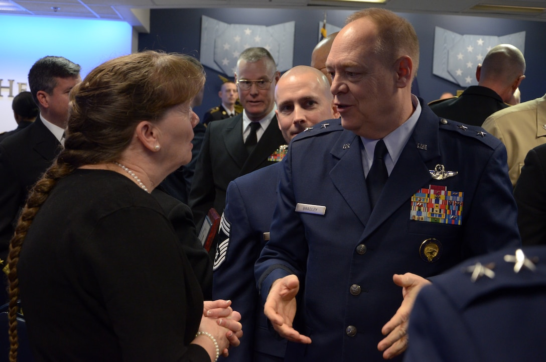 Mrs. Bonnie Rice, the 157th Air Refeuling Wing Airman and Family Readiness Program manager, speaks with Major General Kevin W. Bradley, National Guard Assistant to the Commander, United States Cyber Command and the Director, National Security Agency, after she and her support team from Pease Air National Guard Base, New Hampshire received the 2015 Department of Defense Reserve Family Readiness Award, Pentagon, Washington, D.C., Feb. 26, 2016 (U.S. Air National Guard photo by Tech. Sgt. Aaron Vezeau)