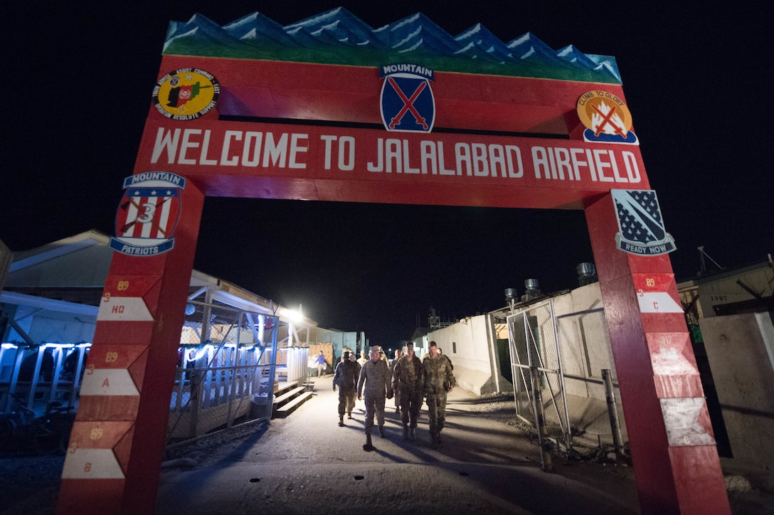 Marine Corps Gen. Joseph F. Dunford Jr., chairman of the Joint Chiefs of Staff, left, and Army Brig. Gen. Michael Howard walk to the flightline on Forward Operating Base Fenty in Jalalabad, Afghanistan, March 2, 2016. DoD photo by D. Myles Cullen