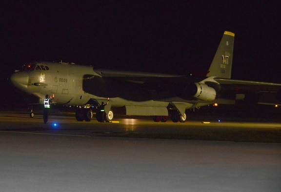 A B-52 Stratofortress from the 69th Expeditionary Bomb Squadron, deployed from Minot Air Force Base, N.D., lands March 2, 2016, at Andersen Air Force Base, Guam. A new rotation of aircrews, maintenance personnel and aircraft assigned to the 69th EBS arrived on Guam to replace the 23rd EBS in support of the U.S. Pacific Command's continuous bomber presence mission. (U.S. Air Force photo/Airman 1st Class Arielle Vasquez)