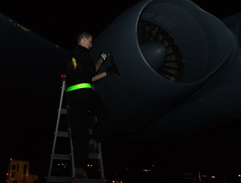 Staff Sgt. Nicholas Tullis, 36th Expeditionary Aircraft Maintenance Squadron crew chief, performs an engine inlet and exhaust inspection on a B-52 Stratofortress supporting the continuous bomber presence March 3, 2016, at Andersen Air Force Base, Guam. CBP missions began March 2004 and are designed to enhance regional security and provide reassurance to allies and partners that the United States is capable to defend its national security interests in the Indo-Asia-Pacific region. (U.S. Air Force photo/Airman 1st Class Arielle Vasquez)